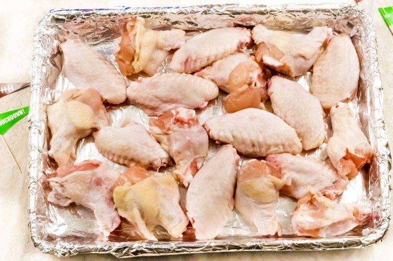 2. Spread wings onto rimmed baking sheet sprayed with cooking spray.